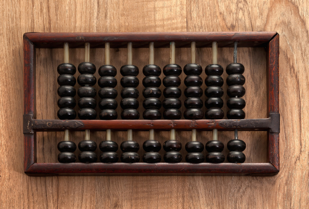 Old abacus on wooden table
